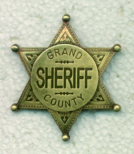 INSIGNIA PLACA GRAND COUNTY SHERIFF LATÓN.
